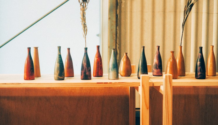 Play of color: These vases, created by designer MoonRounds, are among the pieces created to celebrate Japanese wood artistry that are on display at an exhibition at the dia.lo.gue art space in Kemang, South Jakarta, until Nov. 11.