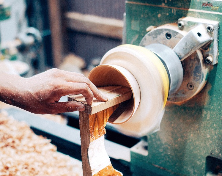 Handmade: An Apple Jack studio craftsman uses a lathe to form a piece of wood.