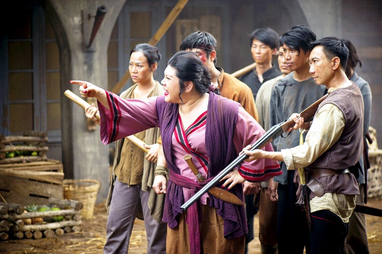 Joanne Kam (center), the queen of Malaysian stand-up comedy, gets serious for her role in the period action drama. She plays Chi, the madam of Grisse's brothel. Image: HBO Asia