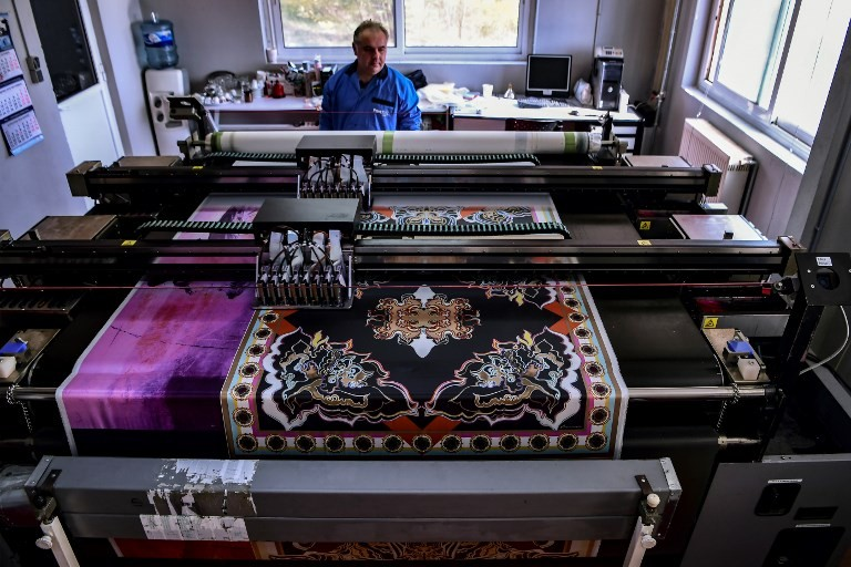 A man works at a silk printing fabric factory in the Greek northern town of Soufli on October 10, 2018.