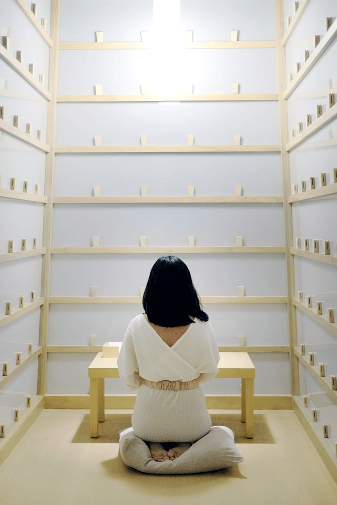 A letter to my grandma: A visitor writes a letter inside a booth of Lee Mingwei's The Letter Writing Project. The installation is rooted in his routine of writing letters to his deceased grandmother over the course of one-and-a-half years.