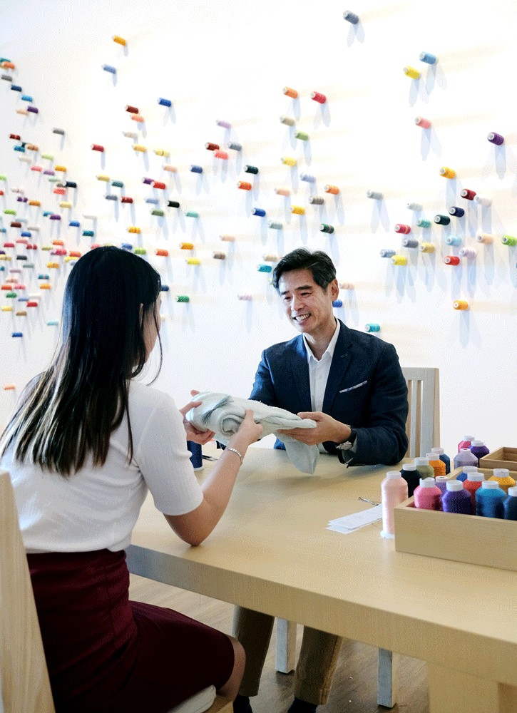 Everything fixed: Lee Mingwei (right) interacts with a visitor at The Mending Project, which offers visitors the chance to have a conversation with a volunteer while the volunteer mends their clothes.
