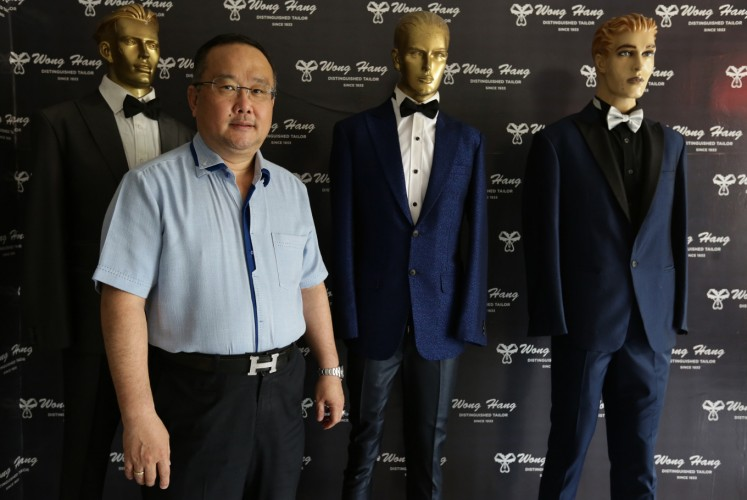 Peter Wongso, owner and one of the designers of Wong Hang Tailor, is pictured at the Wong Hang Tailor outlet in South Jakarta on Nov. 19.