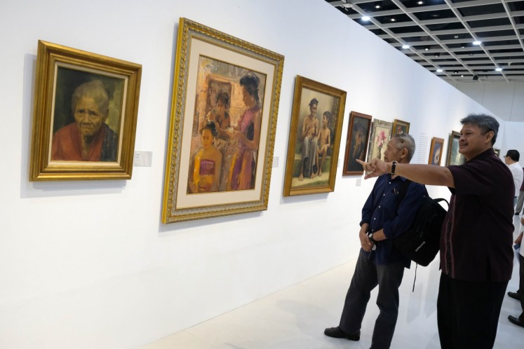 Respecting authenticity: Syakieb Sungkar (right), the editor of a book titled Melacak Lukisan Palsu (Tracing Fake Paintings), and prolific writer Goenawan Mohamad admire paintings at the Maestro dan Para Pengikutnya (Maestros and their Disciples) exhibition at Ciputra Artprenuer in Jakarta on Thursday.