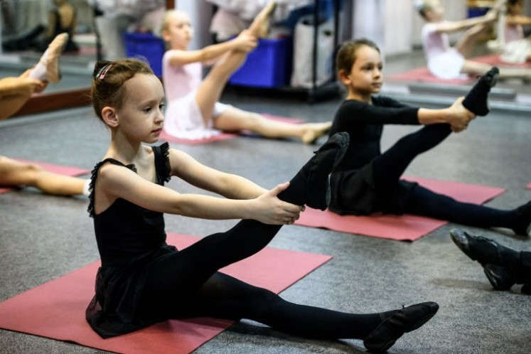 Girls attend a class at a ballet studio in Moscow on November 22, 2018.