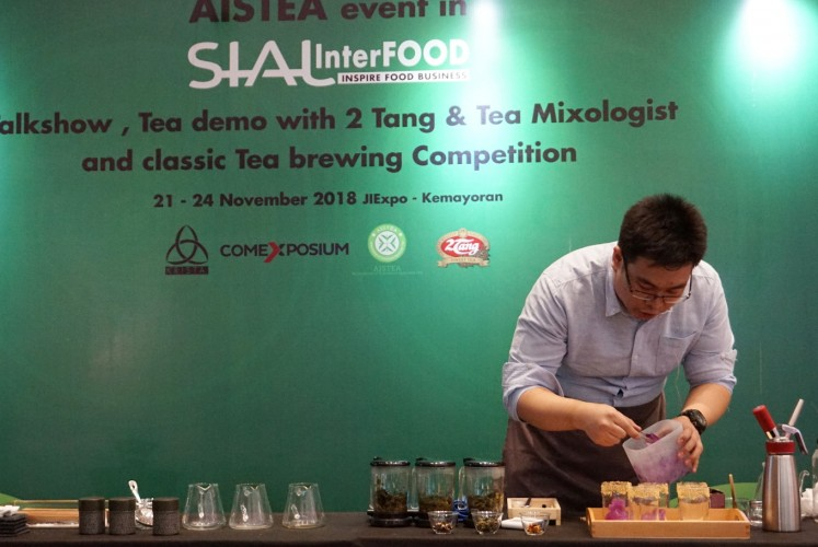 Adrianus Kurniawan competes in the Indonesia Tea Brewing Competition on Saturday, Nov. 24, at JIEXpo Kemayoran, Central Jakarta.