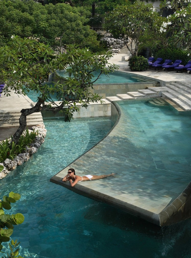 A guest in the River Pool of Ayana Resort & Spa Bali