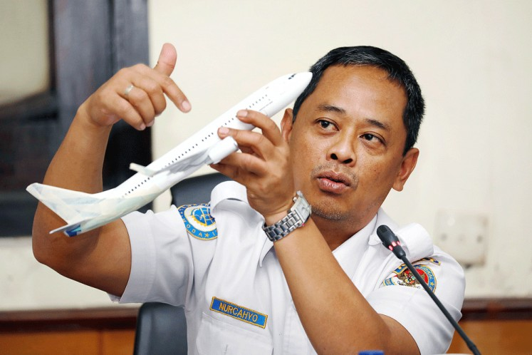 Not airworthy: The National Transportation Safety Committee's (KNKT) sub-committee head for air accidents, Nurcahyo Utomo, shows the flight trajectory of Lion Air flight JT610 using a model plane at a news conference in Jakarta on Wednesday.