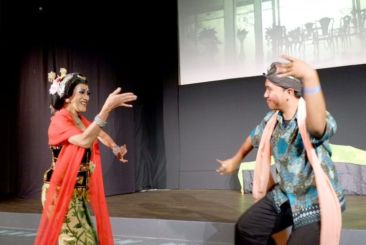 Sway with me: Didik (left) performs lengger senggot with a member of the audience. Despite its feminine characteristics, the dance has been performed by men in Banyumas, Central Java, since the 18th century.