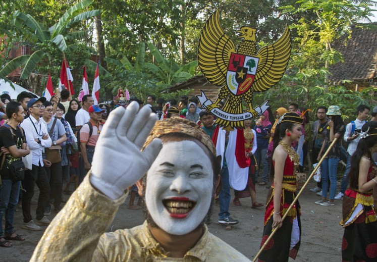 Warm welcome: The Garuda Pancasila march marks the opening of the 2018 Ngayogjazz Jazz Festival.