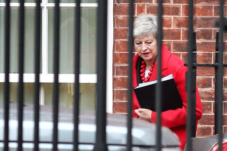 British Prime Minister Theresa May leaves Downing Street in London to answer questions regarding the Brexit withdrawal agreement from a parliamentary committee on Thursday.