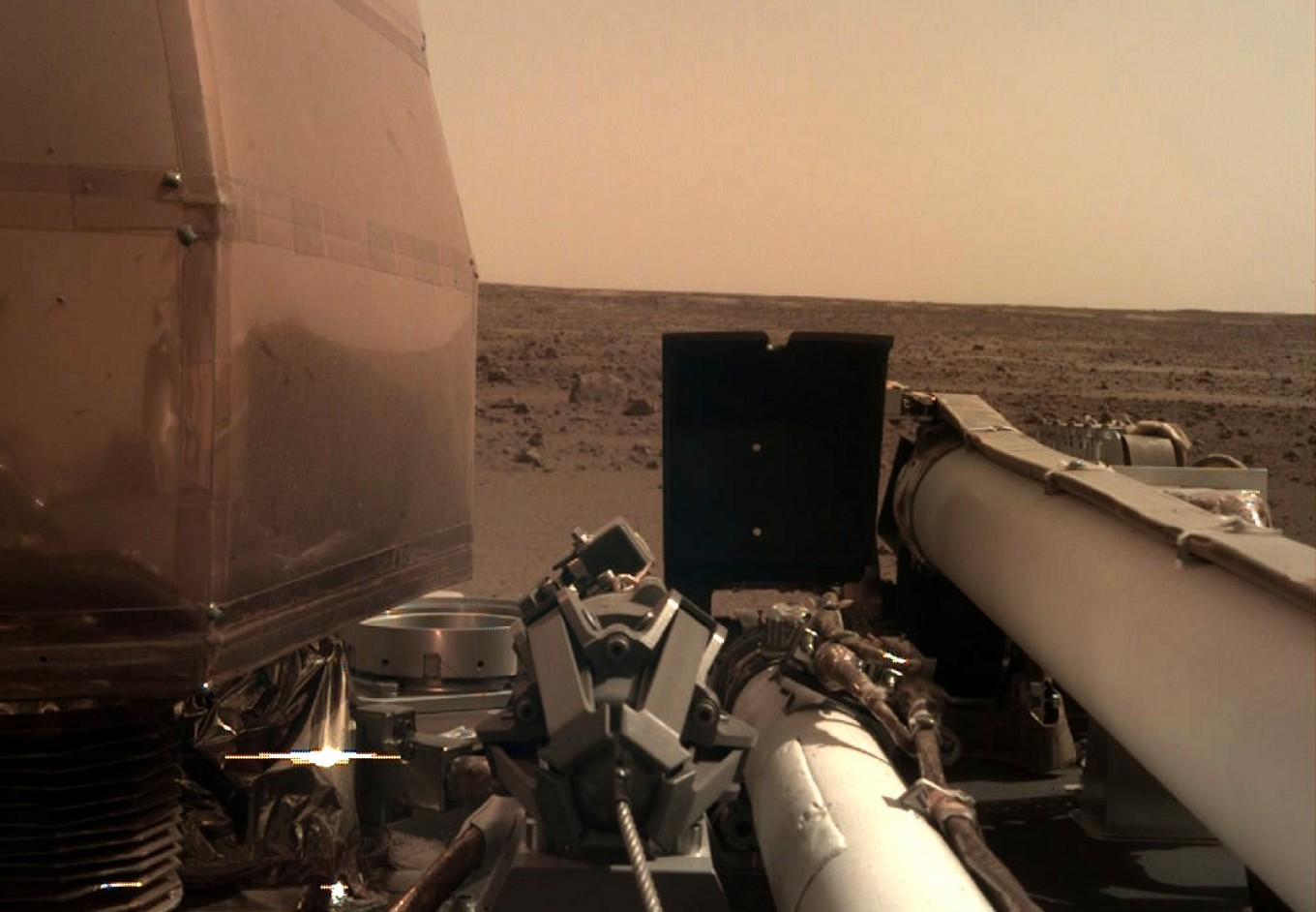 Safely on Mars, InSight unfolds its arrays and snaps some pics