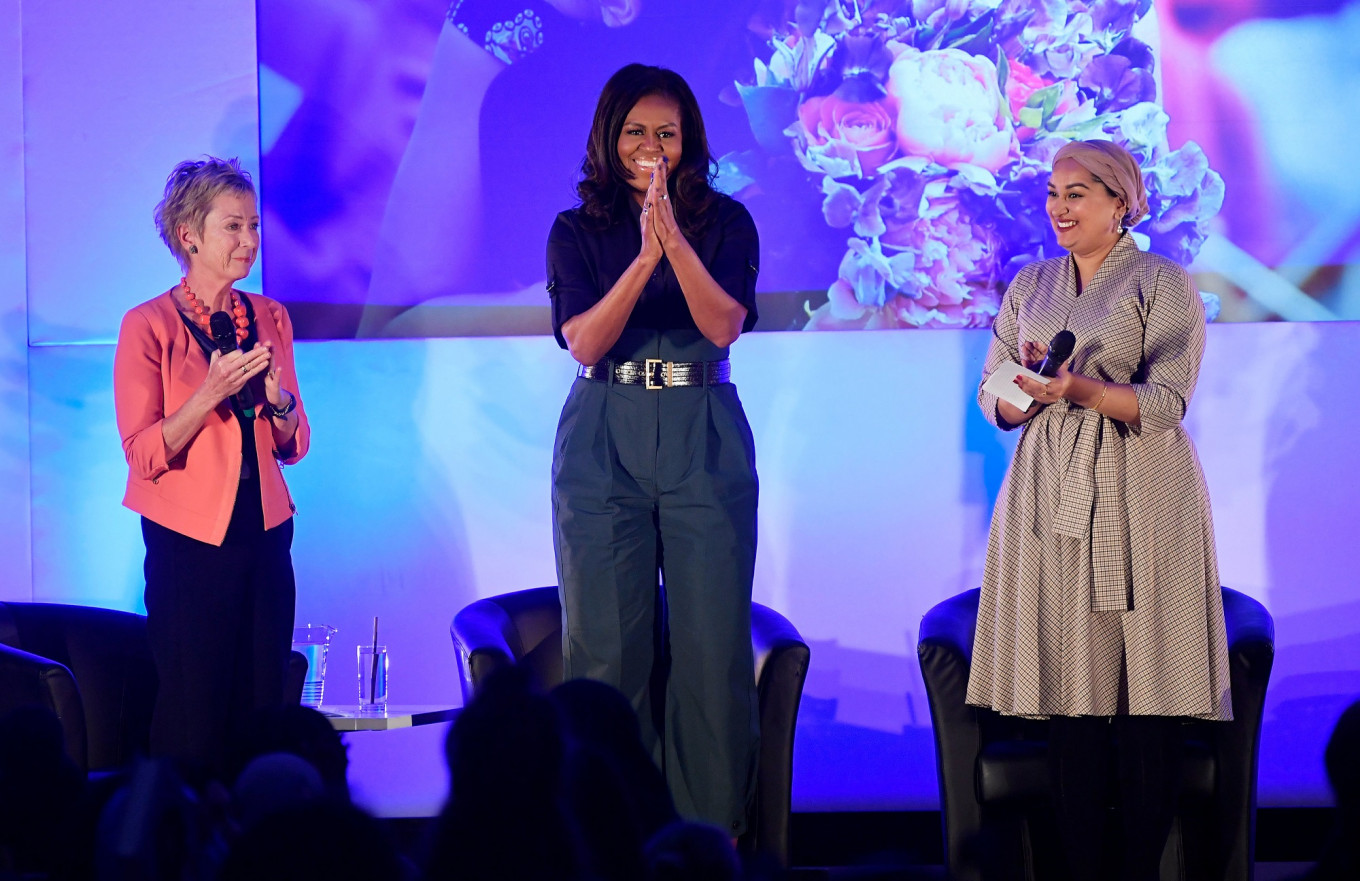 Michelle Obama urges UK schoolgirls to end 'nastiness' in politics by voting