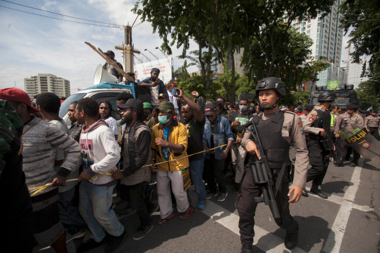 The East Java Police and Surabaya Police deployed 1,055 police officers, aided by two Army groups and the Surabaya Public Order Agency (Satpol PP), to disperse a clash between members of the Papuan Students Alliance and other groups that accused them of committing treason.