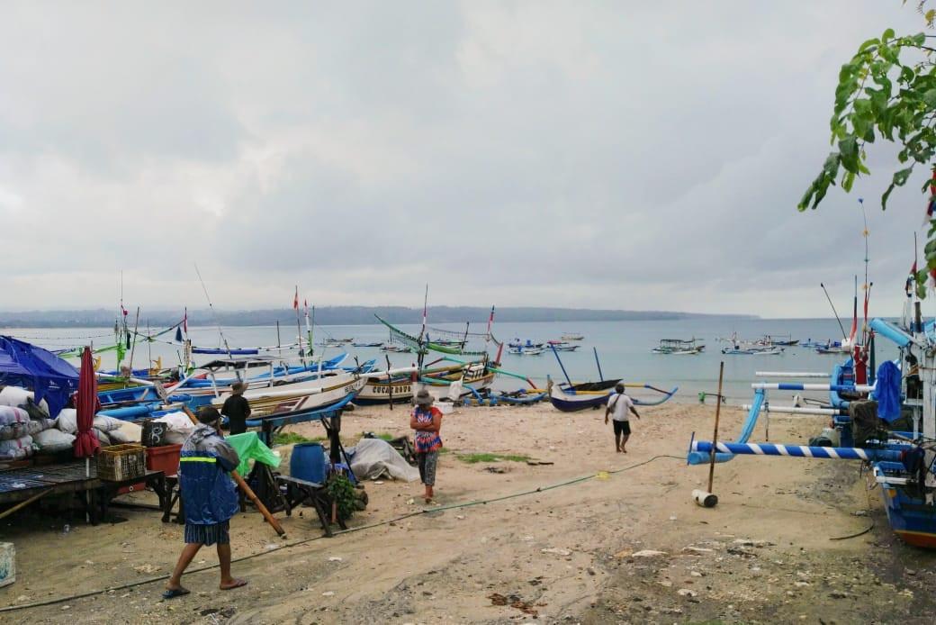 A cloudy day at Jimbaran beach, Bali, near the Kedonganan fish market.