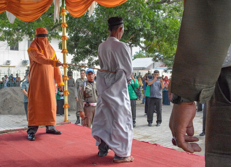 Aceh whips men for sharia-banned gambling