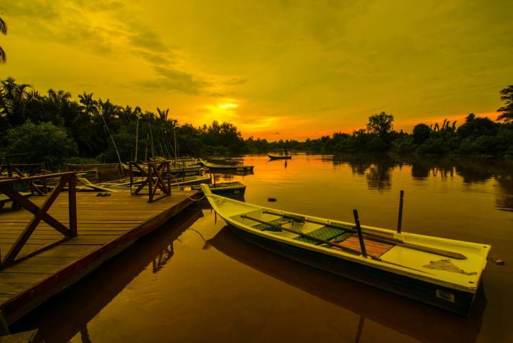 View of sunset from a jetty of Kampung Kuantan, Kuala Selangor.