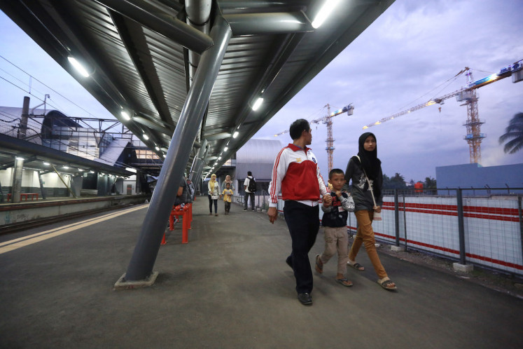 Passengers walk under a renovated canopy at Cisauk Station in Tangerang regency on Dec. 16. Cisauk has had a facelift because the erstwhile remote station will be the transit hub for middle-income bracket housing developed by giants like PT Sinar Mas Land or smaller companies.
