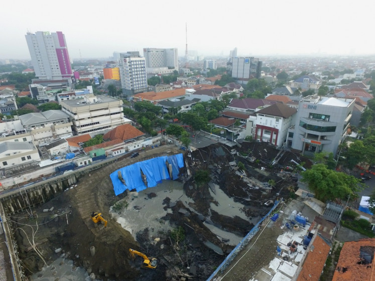 'I thought it was an earthquake': Giant sinkhole opens on busy Surabaya road