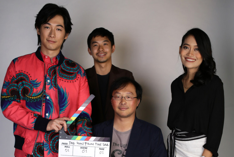 Cast and director of 'The Man from the Sea (Laut)'; Dean Fujioka (left), Taiga (Second left),  Sekar Sari (right) and Koji Fukada, during their interview on Monday, Dec. 17, at The Jakarta Post office in Central Jakarta.