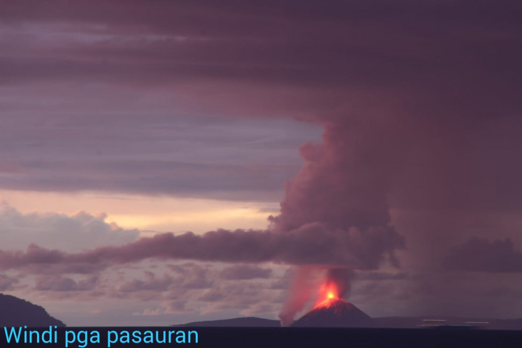 A photo of Mount Anak Krakatau erupting taken from a monitoring station in Pasauran, Anyer Beach, on Saturday evening, December, 22, 2018.
