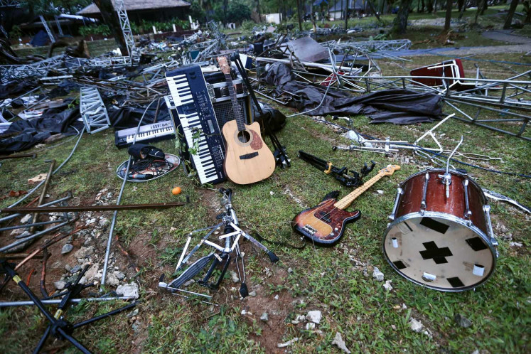 Seventeen band's musical instruments are scattered on the grounds of Tanjung Lesung Resort in Pandeglang regency, Banten, following the tsunami strike on Saturday, Dec. 22.