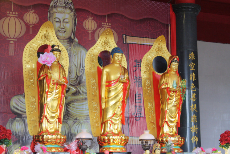 The vihara's inauguration ceremony on Sunday included raising the statues of three Buddhist goddesses.