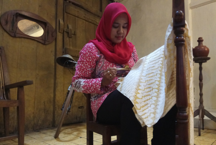 Cafés in Kauman village show visitors how to make batik.