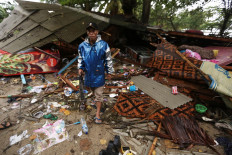 Lost property: A man tries to salvage on Sunday belongings from his home, which was destroyed by a tsunami that hit Carita Beach in Pandeglang, Banten, on Saturday night December 22, 2018. JP/Dhoni Setiawan