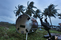 Forlorn: Musical instruments belonging to pop band Seventeen can still be found scattered on the ground on Sunday, December 23. 2018. Several members of the band died after a tsunami hit Tanjung Lesung Resort, Pandeglang, Banten, on Saturday. The National Disaster Mitigation Agency (BNPB) reported that as of Tuesday, 429 people had been killed in the catastrophe. JP/Dhoni Setiawan