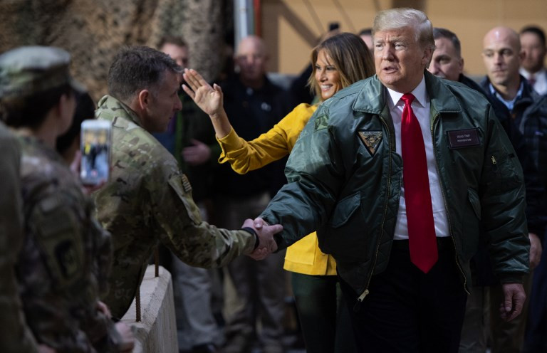 Trump declares end to US 'policeman' role in surprise Iraq visit