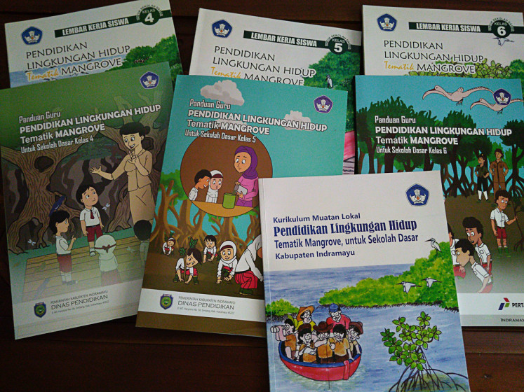 Raising awareness: School textbooks published by the government aim to educate students on mangrove conservation.