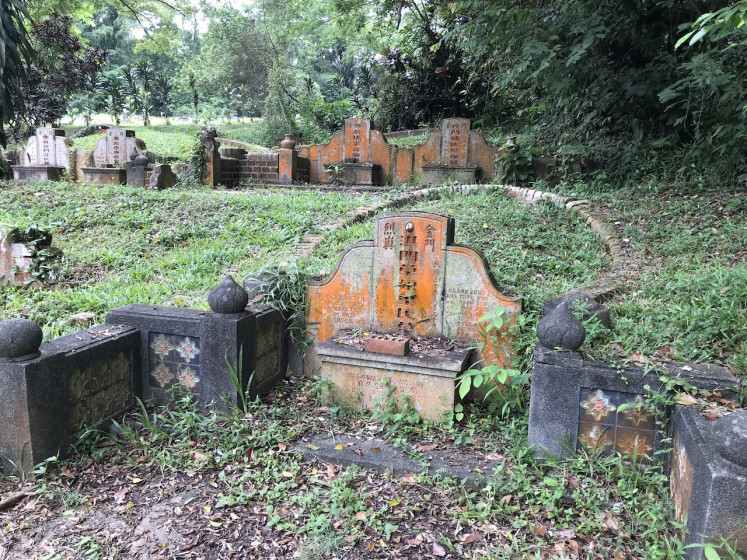 Graves with Chinese inscriptions in Bukit Brown cemetery, one of the oldest cemeteries Singapore, which is scheduled to be cleared for housing by 2030. Nov 11, 2018.