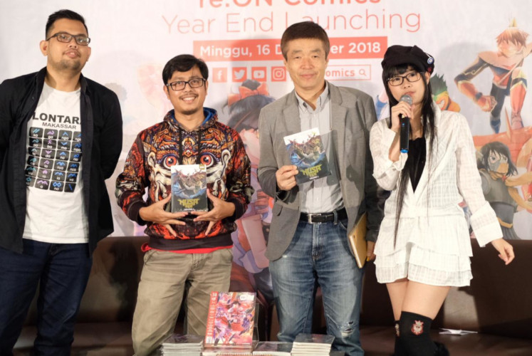 Sweta Kartika (second left), the writer and creator of 'Nusa V', and Bunsho Kajiya (second right), director of Shogakukan Asia Pte Ltd., appear during the launch of the comic book on Sunday, Dec. 16, 2018, at the Kinokuniya bookstore in Plaza Senayan, Central Jakarta.