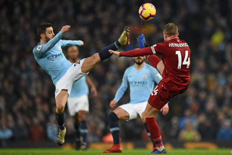 Man City snap Liverpool's unbeaten run to reignite title race
