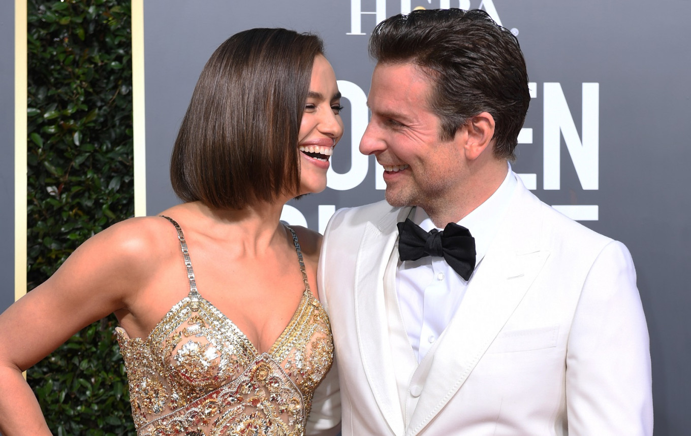 Best Actor in a Motion Picture – Drama and Best Director – Motion Picture for  'A Star is Born' nominee Bradley Cooper (R) and his partner Russian model Irina Shayk arrive for the 76th annual Golden Globe Awards on Jan. 6, 2019, at the Beverly Hilton hotel in Beverly Hills, California.