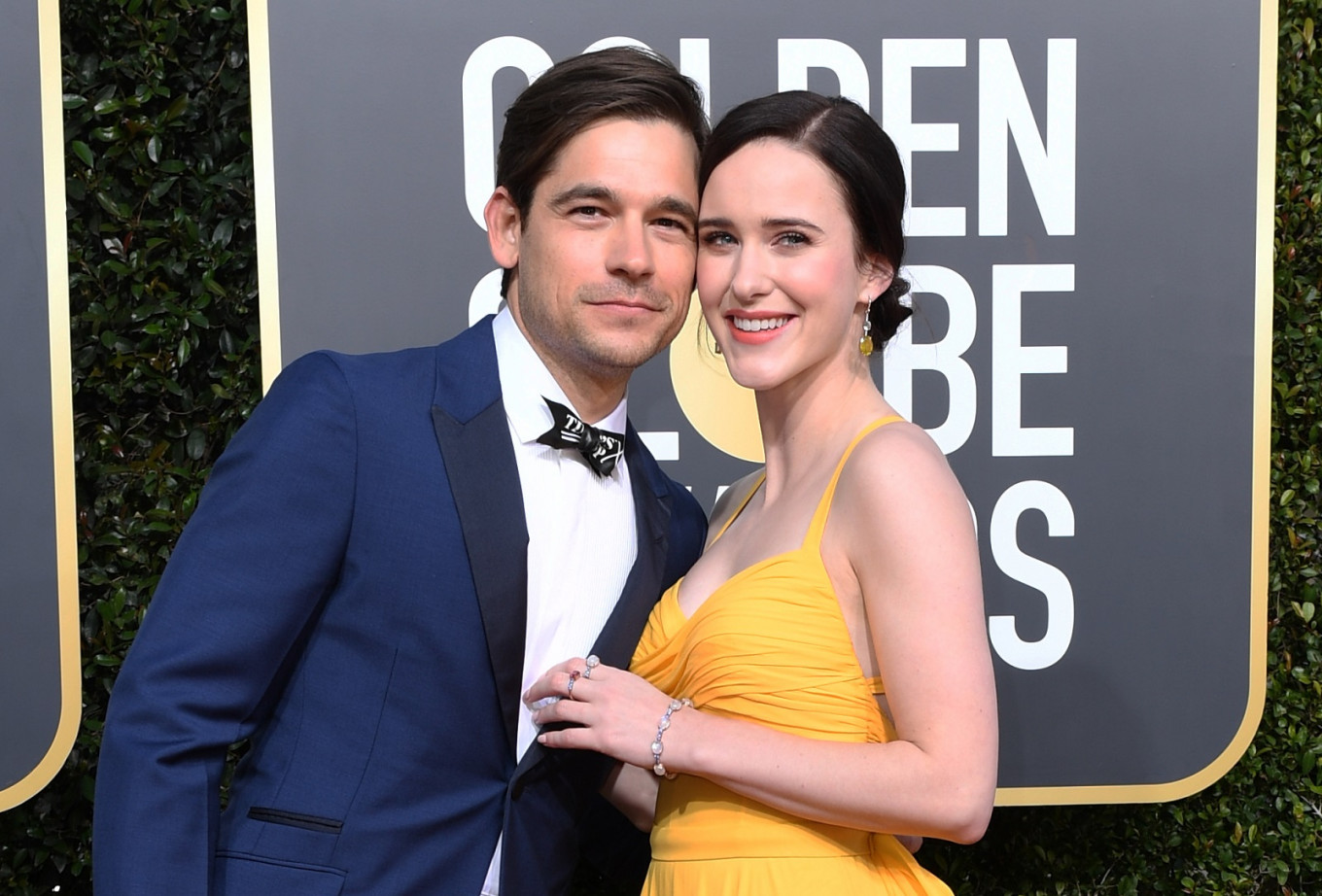 Best Performance by an Actress in a Television Series – Musical or Comedy for 'The Marvelous Mrs. Maisel' nominee Rachel Brosnahan (R) and US actor Jason Ralph arrive for the 76th annual Golden Globe Awards on Jan. 6, 2019, at the Beverly Hilton hotel in Beverly Hills, California.