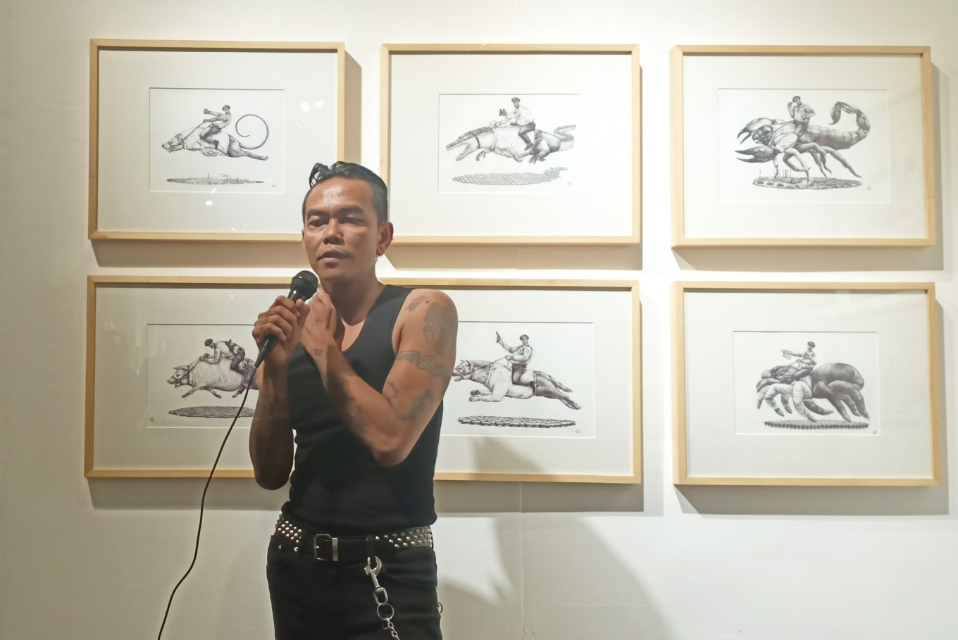 Surakarta-born artist Aris Prabawa speaks during the opening of the 'Hadap Hidup' exhibition at the Jogja National Museum in Yogyakarta, on Jan. 5, 2019.