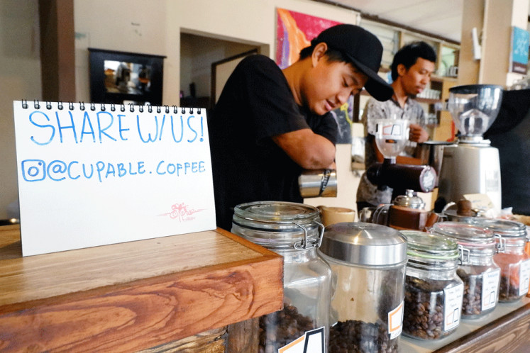 A cup to share: At Cupable café in Yogyakarta, disabled and able-bodied baristas join forces to serve coffee and change people's perception of people with disabilities.