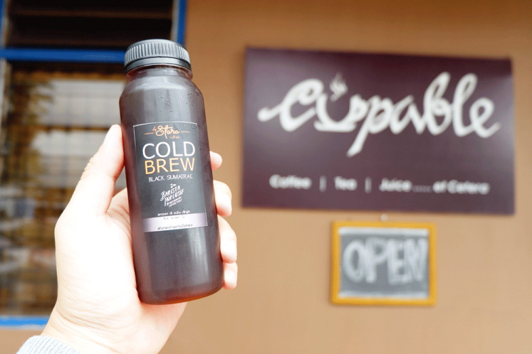Coffee to go: Setara Coffee (Equal Coffee) is a brand of bottled cold brew produced by Ade Amita Bacan, a Cupable barista with paralized legs.
