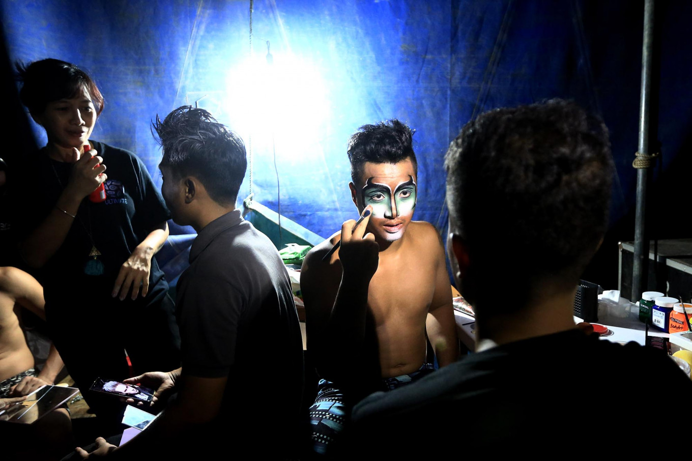Get ready: Oriental Circus Indonesia performers put on make up and face paint before their performance. JP/Dhoni Setiawan