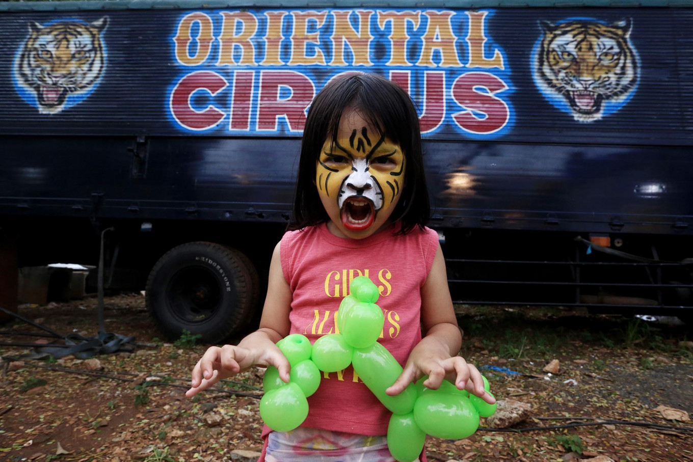Hear me roar: A girl, Lembayung Langit Senja, growls like a tiger as she waits for the opening of The Great 50 Show by the Oriental Circus Indonesia. JP/Dhoni Setiawan