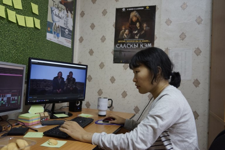 n this picture taken on November 29, 2018 Yakutian filmmaker Lyubov Borisova works on her film in Sakhafilm production studio office in Yakutsk.