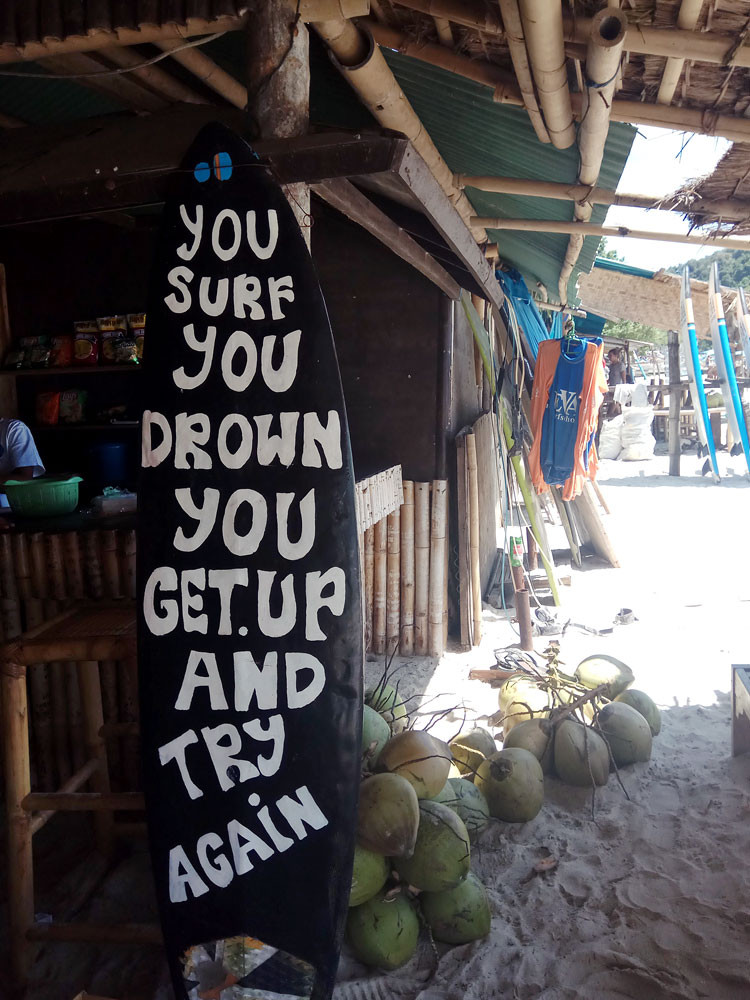 Never give up: A surfboard provides encouragement for new surfers.