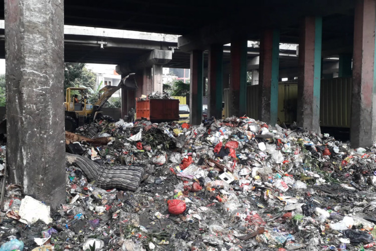Trash dumped under toll road after major clean-up