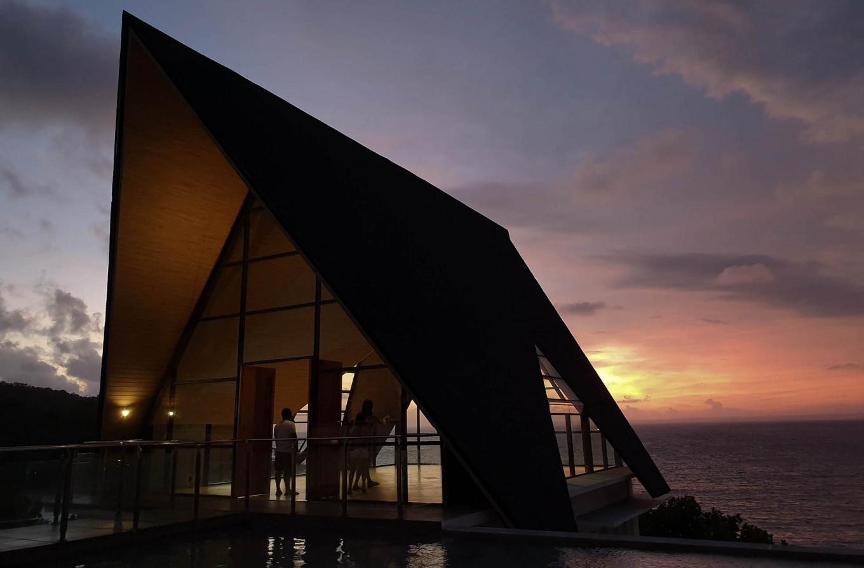 Tourists capture the sunset on the west coast of Pangandaran on Jan. 3, 2019. JP/Arya Dipa