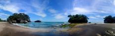Three giant rocks on Madasari Beach are a popular spot for a photo shoot among tourists. JP/Arya Dipa