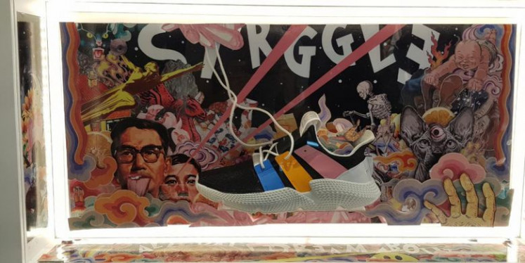 Sneaker with artwork by collage artist Ganiks.