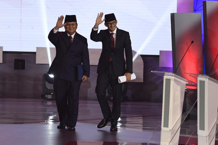 The challengers Prabowo Subianto and Sandiaga Uno wear suits to the first presidential debate.
