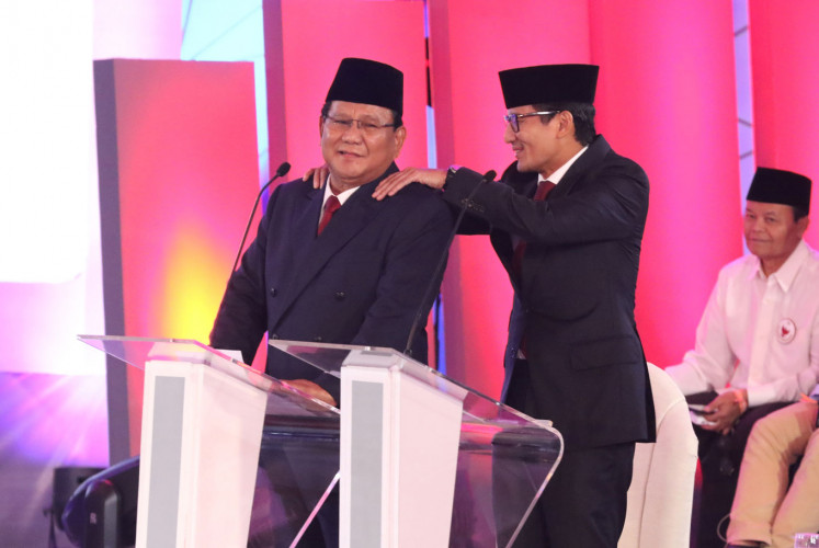 Vice presidential candidate Sandiaga Uno (right) gives running mate Prabowo Subianto a backrub during the first candidate debate on Jan. 18, 2019.